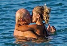 Photo of GOT's 'Tywin Lannister' displays his youthful physique as he shares a kiss with a younger female companion at the beach