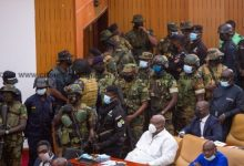 Photo of Photos: Soldiers storm parliament to restore calm after chaotic voting process